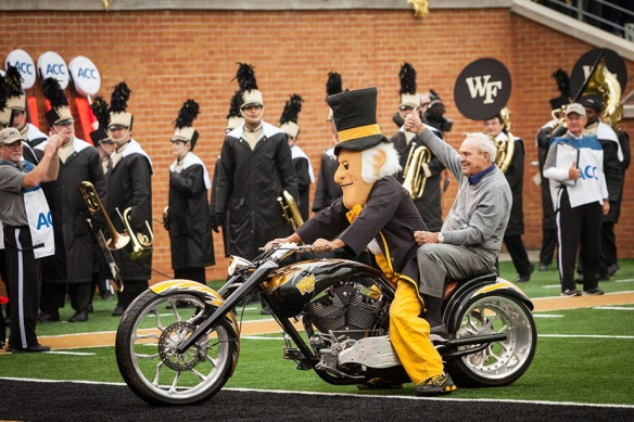 Wake Forest hosts Homecoming 2013 at BB&T Field on Saturday, October 19, 2013. Gold Legend Arnold Palmer rides the Deacon's motorcycle at the start of the game.